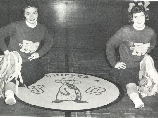 A photo, dated 1959, shows two cheerleaders posing