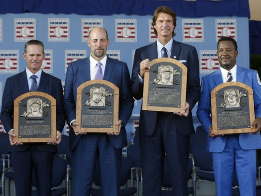 2015 Baseball Hall of Famers from left, Craig Biggio, John Smoltz, Randy Johnson and Pedro Martinez hold their plaques in Cooperstown, N.Y.