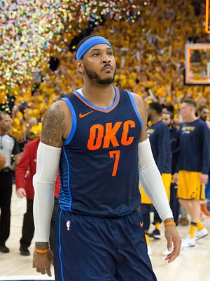 Oklahoma City Thunder forward Carmelo Anthony (7) walks off the court after losing game six of the first round of the 2018 NBA Playoffs against against the Utah Jazz at Vivint Smart Home Arena.