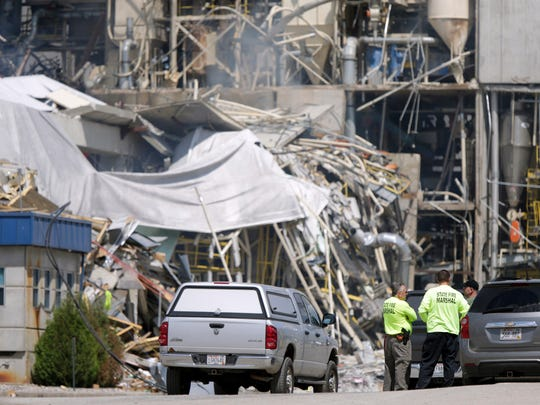 State fire marshals work at Didion Milling Plant in the Village of Cambria, Wis., Friday, June 2, 2017. An explosion at the plant on Wednesday night killed three employees and injured about a dozen others. A fourth died from injuries sustained in the blast.
