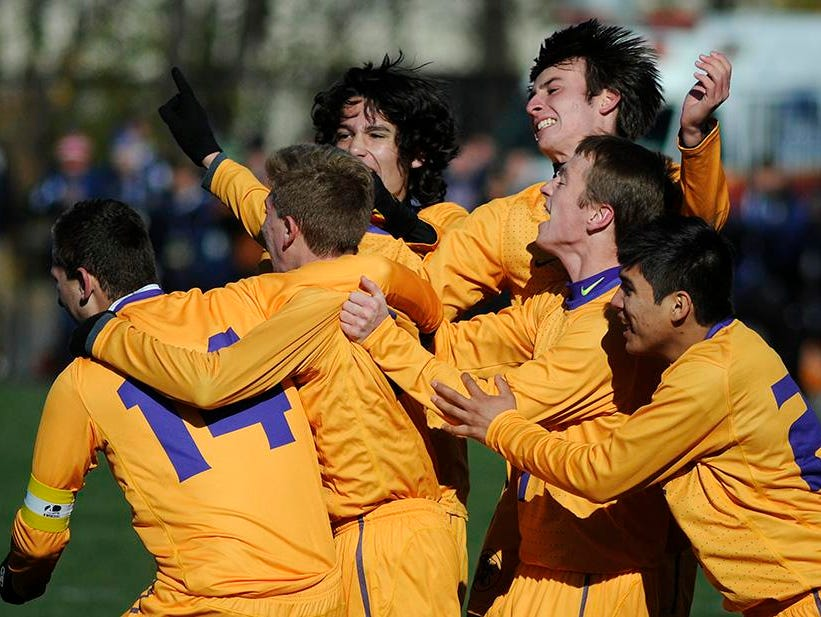 The Rhinebeck High School boys soccer team celebrates its win in the Section 9 Class C state semifinals on Nov. 15, 2014 in Middletown.