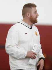 Alex Golesh, tight ends coach and recruiting coordinator, talks players Tuesday, March 8, 2016, during spring practice in the Bergstrom Football Complex at Iowa State University in Ames.