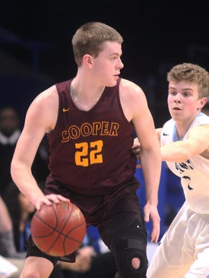 Cooper senior Sean McNeil looks for an opening during Cooper's state quarterfinal game vs Collins in the KHSAA Sweet 16 March 17, 2017 at Rupp Arena in Lexington, Ky.