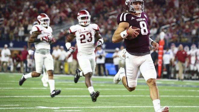 Texas A&M quarterback Trevor Knight (8) scores a touchdown against Arkansas in the second quarter at AT&T Stadium in Arlington, Texas, on Saturday, Sept. 24, 2016. (Richard W. Rodriguez/Fort Worth Star-Telegram/TNS)