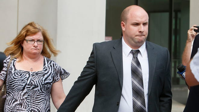 Brendan Cronin, the New York City police officer accused of randomly shooting at a car in Pelham, leaves Westchester County Courthouse after pleading not guilty to attempted murder and assault charges, July 10, 2014 in White Plains.