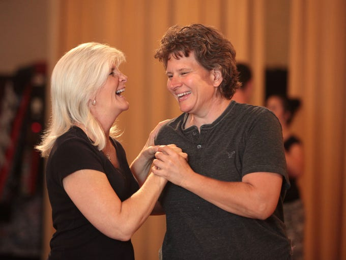 Mary and Sue Hilsabeck-Huber laugh during a dance lesson