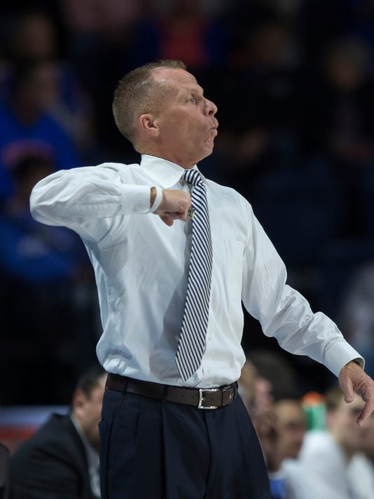 North Florida head coach Matthew Driscoll yells instructions to his team during the first half of an NCAA college basketball game against Florida in Gainesville, Fla., Thursday, Nov. 16, 2017. (AP Photo/Ron Irby)
