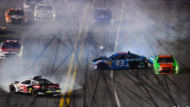 Austin Dillon (3), Aric Almirola (43) andDanica Patrick (10) wreck during the Daytona 500 at Daytona International Speedway.