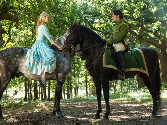 "This image released by Disney shows Lily James as Cinderella, left, and Richard Madden as the Prince in Disney's live-action feature inspired by the classic fairy tale, ""Cinderella."""