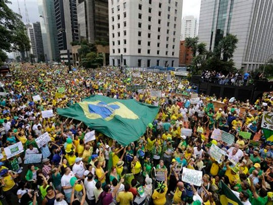 Demonstrators march to demand the impeachment of Brazil's President Dilma Rousseff in Sao Paulo, Brazil, on Sunday, March 15, 2015. Brazilians are demonstrating amid an inquiry into a kickback scheme at government-run oil company that prosecutors call the biggest corruption case yet uncovered in Brazil.