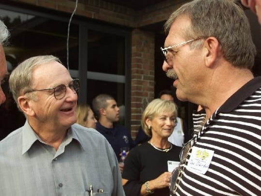Bo Schembechler, left, and Dan Dierdorf chat at a reception honoring Schembechler's 30 years with U-M in May 1999.