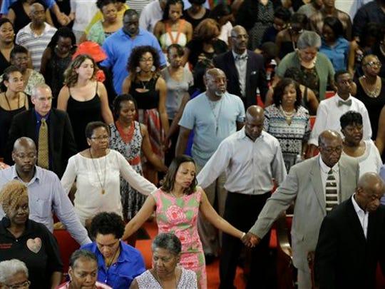 Parishioners sing at the Emanuel A.M.E. Church Sunday,