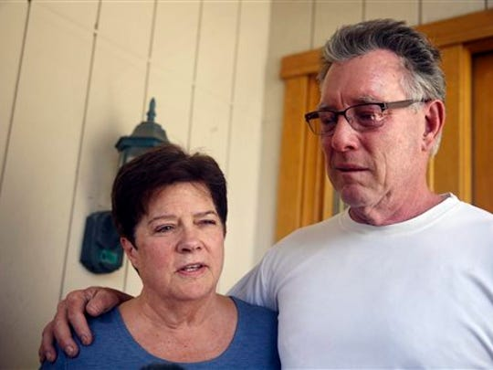 Liz Sullivan, left, and Jim Steinle, right, parents of Kathryn Steinle, talk to members of the media outside their home Thursday, July 2, 2015 in Pleasanton, Calif. Kathryn Steinle was shot to death, apparently at random, while walking with her father Jim and a friend along a popular pedestrian pier on the San Francisco waterfront. The woman was shot Wednesday evening at Pier 14 and died at a hospital.