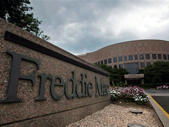 This July 13, 2008, file photo shows the Freddie Mac corporate office in McLean, Va. Mortgage giant Freddie Mac reported net income of $4.2 billion for the second quarter, up sharply from the same period of 2014, as it increased its purchases of home loans and sold off greater volumes of riskier mortgages. The April-through-June results posted Tuesday marked the government-controlled company's 15th straight profitable quarter. Freddie also benefited from rising interest rates.