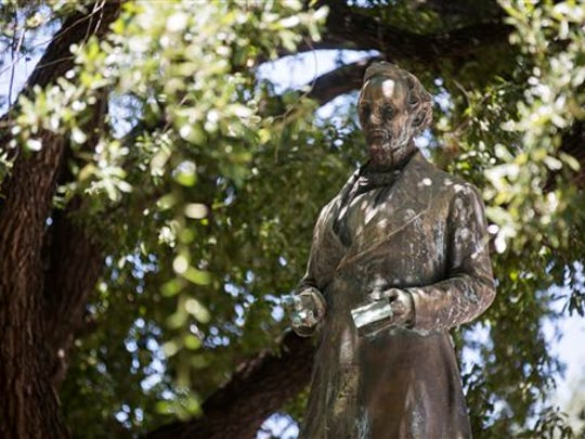 This Aug. 10, 2015. photo shows the Jefferson Davis statue in the South Mall of the University of Texas in Austin, Texas.