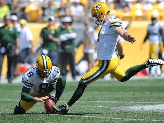 Green Bay Packers kicker Mason Crosby (2) hits a 55-yard field goal as Tim Masthay holds in the third quarter of the NFL pre-season football game against the Pittsburgh Steelers, Sunday, Aug. 23, 2015 in Pittsburgh.