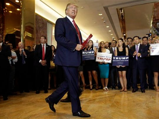 Republican presidential candidate Donald Trump walks to the podium to address a news conference, at Trump Tower, in New York, Thursday, Sept. 3, 2015. The Republican candidates for president started putting pen to paper on Thursday, pledging not to mount a third-party bid.