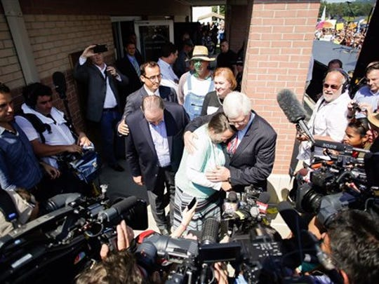 Rowan County clerk Kim Davis, center, hugs her attorney,