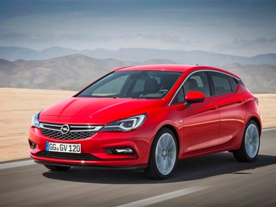 The photo released by General Motors shows the new Opel Astra. GM's redesigned Opel Astra will have its world premiere at the Frankfurt car show.  (Opel/GM via AP)