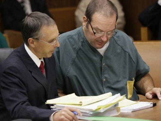 Ronald Ambrose and his client Bob Bashara look over notes as Bashara takes the stand in the courtroom of Judge Vonda Evans at the Frank Murphy Hall of Justice Thursday Oct. 15, 2015 for his hearing on a motion to seek a new trial.