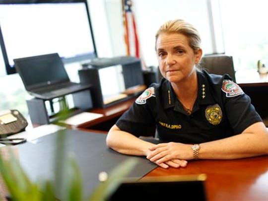 "Chief Bernadette DiPino, of the Sarasota Police Department, sits for a portrait at her office on Sept. 28, 2015 in Sarasota, Fla. As an officer in Ocean City, Maryland, Bernadette DiPino encountered what she called a ""laissez faire"" attitude about sexually inappropriate behavior. DiPino is now chief of the Sarasota Police Department in Florida and helped develop the International Association of Chiefs of Police report on sexual misconduct."