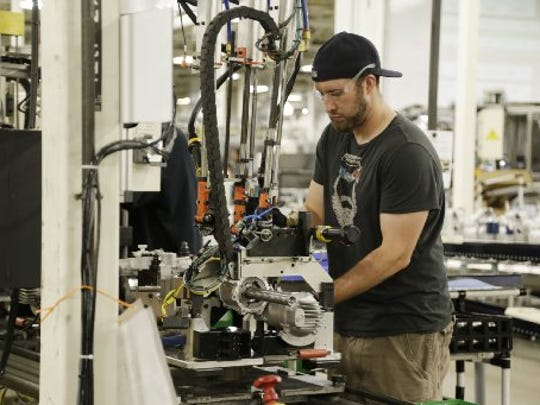 Denny Langworthy assembles part of a power steering column at Nexteer Automotive, an auto supplier with a plant in Saginaw.