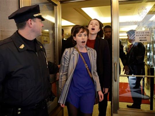 Activists are ejected from The Plaza Hotel, where Republican presidential candidate Donald Trump is attending the Pennsylvania Republican party's annual Commonwealth Club luncheon, Friday, Dec. 11, 2015, in New York.
