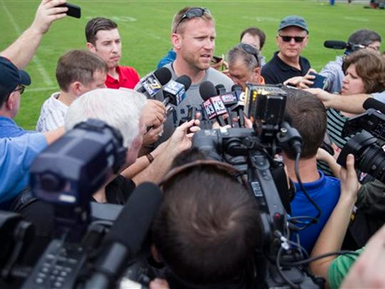 Ricky Rahne, seen here talking to the media, is entering his second season as Penn State's offensive coordinator.