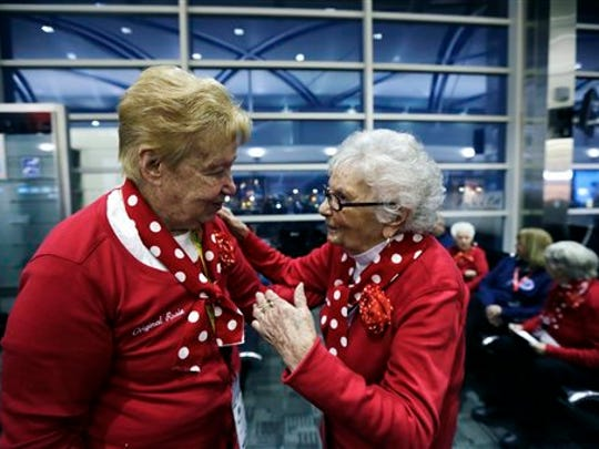 Former Rosies Betty Pazdro, left, talks with Mellie Mallon, before boarding a flight at Detroit Metropolitan Airport, Tuesday, March 22, 2016, in Romulus, Mich.