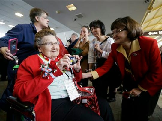 Former Rosie, Helen Jedele photographs her arrival at the Ronald Reagan Washington National Airport, Tuesday, March 22, 2016 in Washington.