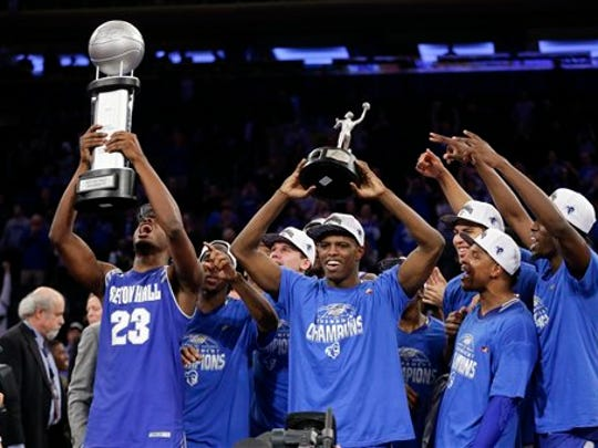 Seton Hall's Isaiah Whitehead, center, celebrates with teammates while holding the Big East Tournament's Most Outstanding Player trophy.