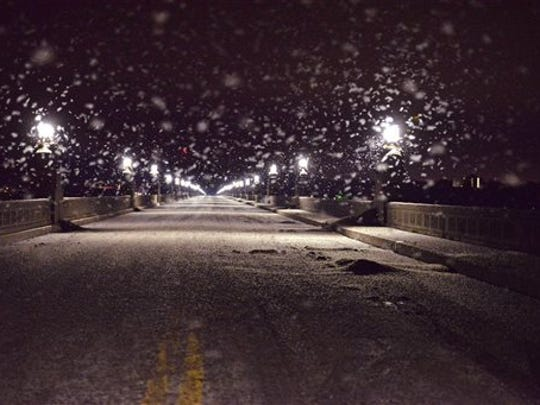 A swarm of mayflies hovers over the Route 462 bridge