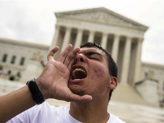 Gerson Quinteron of Washington yells during a demonstration