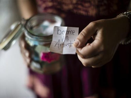 "Stephanie Moyer displays one of her daughter Victoria ""Tori"" Herr's dreams kept on scraps of paper in a jar, during an interview with The Associated Press in Lebanon, Pa., Friday, July 8, 2016. Herr died Easter Sunday 2015 following heroin withdrawal days into her first jail stint."