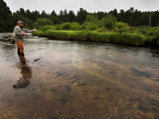 Angler Chris Atkins of Allendale, Mich., fly fishes on a pristine meandering stream inside Rocky Mountain National Park, near Estes Park, Colo., on Aug. 4, 2016. Atkins, often with his father and son, usually spends a few weeks each summer at the park, which has been a family tradition for decades. (AP Photo/Brennan Linsley)