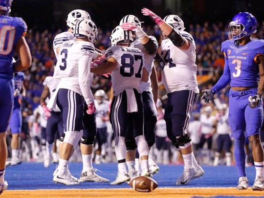 BYU celebrates a touchdown during the second half of an NCAA college football game against Boise State in Boise, Idaho, Thursday, Oct. 20, 2016. Boise State won 28-27.