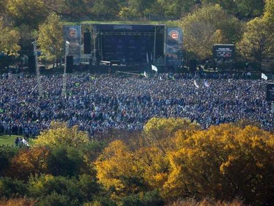 Fans gather at Grant Park for a rally honoring the