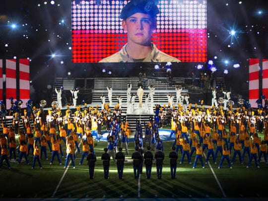 "This image released by Sony Pictures shows Joe Alwyn, portraying Billy Lynn, on a screen in a scene from the film, ""Billy Lynn's Long Halftime Walk,"" in theaters on November 11."