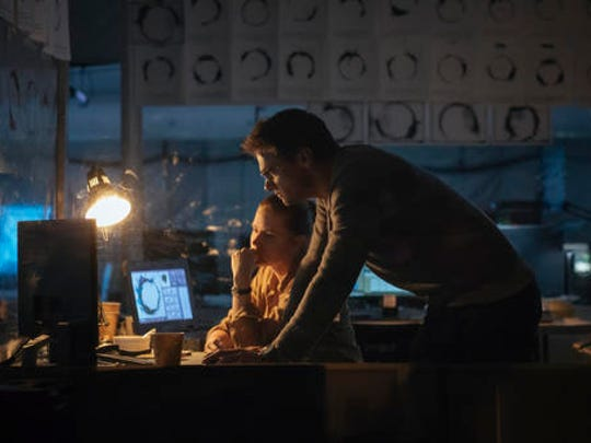 "This image released by Paramount Pictures shows Jeremy Renner, right, and Amy Adams in a scene from ""Arrival."""