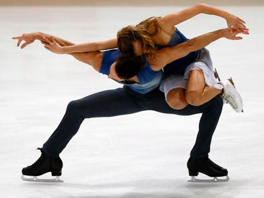 Gabriella Papadakis and Guillaume Cizeron of France compete in the Ice Dance Free Dance Program during the ISU figure skating France's Trophy at Bercy arena, in Paris, France, Saturday, Nov. 12, 2016.