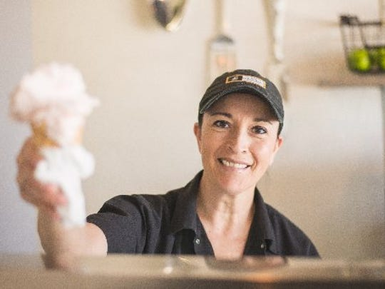 Chef Vita Jarrin of A La Mode Gelateria presents a cone of strawberry shortcake Saturday, July 9, 2016.