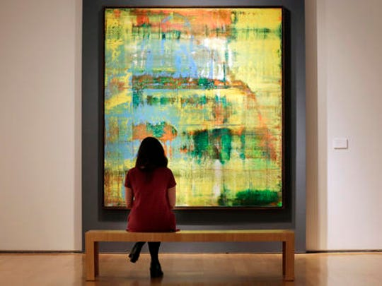 """FILE - In a Friday, Nov. 4, 2016 file photo, Gerhard Richter's """"Abstraktes Bild (809-2)"""" from the collection of Eric Clapton, is displayed at Christie's, in New York. The painting is another major at Christie's auction of contemporary art Tuesday, Nov. 15, 2016."""