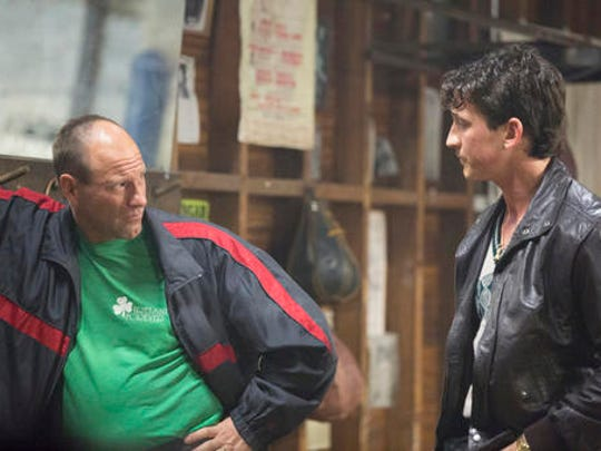 "In this image released by Open Road Films, Miles Teller, right, and Aaron Eckhart appear in a scene from the film, ""Bleed For This."""