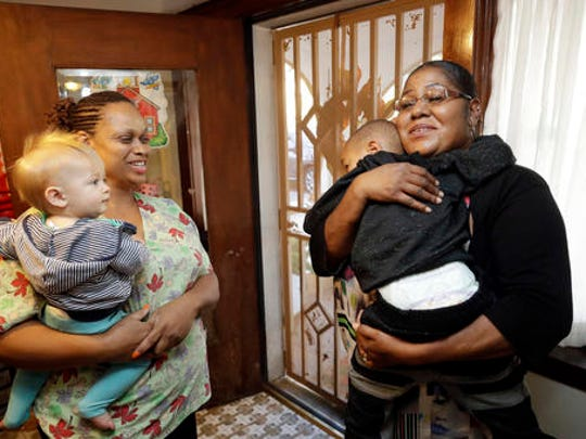 In this Thursday, Oct. 20, 2016, photo, Nancy Harvey, left, owner of Lil' Nancy's Primary Schoolhouse, chats with one her clients, Tamara Purifoy, as she picks up her son Alonzo Simpson, 3, at Harvey's home and child care center, in Oakland, Calif.  Most U.S. households are heading for a worse lifestyle in retirement than they had while they were working, because they simply aren't saving enough, experts say. Harvey, who has less than $2,000 saved despite her decades of work, plans to continue with real-estate classes in hopes that it can provide a second job.