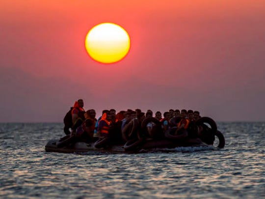 FILE - In this file photo taken on Aug. 13, 2015, migrants on a dinghy approach the southeastern island of Kos, Greece. About 340 migrants have died or gone missing in four Mediterranean Sea shipwrecks over the past two-and-a-half days during the deadliest year on record, as smugglers force departures despite rough, winter seas, a migration organization said Thursday, Nov. 17, 2016.