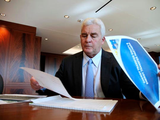 Energy Transfer Partners CEO Kelcy Warren reviews documents at his office in Dallas on Friday, Nov. 18, 2016, about the Dakota Access oil pipeline that is mired in controversy after thousand of protestors have sought to block its expansion underneath a water source close to the Standing Rock Sioux Indian Reservation in North Dakota.