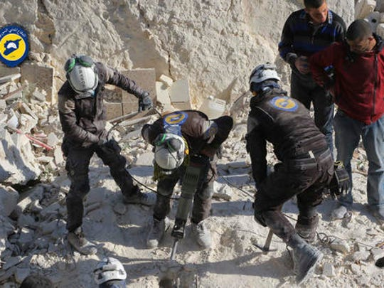 This photo provided by the Syrian Civil Defense White Helmets, which has been authenticated based on its contents and other AP reporting, shows Civil Defense workers using a drill to dig through rubble in search for victims in Aleppo, Syria, Saturday, Nov. 19, 2016. Government bombardment of besieged rebel-held neighborhoods in the northern city of Aleppo killed at least 20 people Saturday Syrian opposition activists said, a day after the health directorate said all hospital in opposition areas have been knocked out of service.