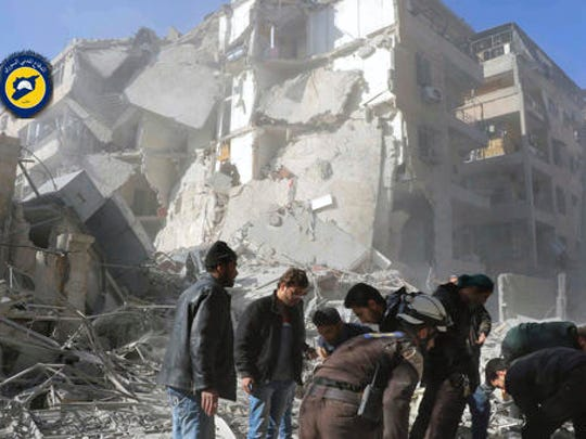 This photo provided by the Syrian Civil Defense White Helmets, which has been authenticated based on its contents and other AP reporting, shows Civil Defense workers and Syrian citizens inspect damage buildings after airstrikes hit the Seif al-Dawleh neighborhood in Aleppo, Syria, Saturday, Nov. 19, 2016. Government bombardment of besieged rebel-held neighborhoods in the northern city of Aleppo killed at least 20 people Saturday Syrian opposition activists said, a day after the health directorate said all hospital in opposition areas have been knocked out of service.