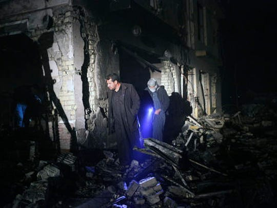 Civilians search for survivors in the rubble at the