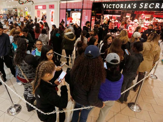 Shoppers queue up in front of Victoria's Secret at the Dartmouth Mall on Black Friday, in Dartmouth, Mass., Nov. 25, 2016.  Stores open their doors Friday for what is still one of the busiest days of the year, even as the start of the holiday season edges ever earlier.